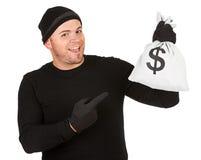 夜贼:指向金钱袋子 免版税库存图片