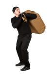 夜贼:逃脱的窃贼尝试粗麻布大袋 库存图片