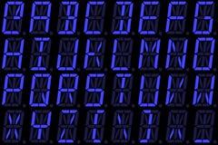 从大写字母的数字式字体在蓝色字母数字的LED显示 库存照片