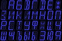 从大写字母的数字式斯拉夫语字母的字体在蓝色字母数字的LED显示 免版税库存图片