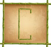 大写字母C做了绿色竹棍子在老纸背景 库存例证