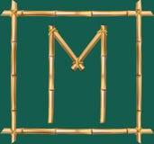 大写字母M做了现实棕色干燥竹杆里面木棍子框架 皇族释放例证