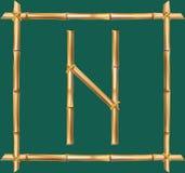 大写字母N做了现实棕色干燥竹杆里面木棍子框架 皇族释放例证
