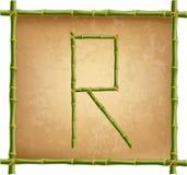 大写字母R做了绿色竹棍子在老纸背景 库存例证