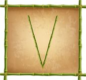 大写字母V做了绿色竹棍子在老纸背景 皇族释放例证
