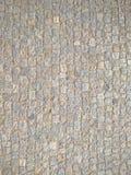 大卵石向铺背景的街道扔石头 免版税图库摄影