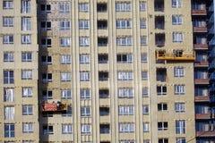 大厦的建筑 工作者温暖外部墙板 库存照片