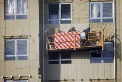 大厦的建筑 工作者温暖外部墙板 免版税库存图片