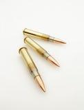 大口径子弹在白色隔绝的Catridges 免版税库存照片