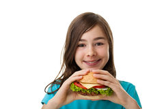 大吃女孩三明治年轻人 库存照片