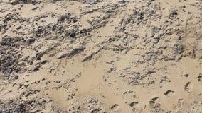 大堆沙子和脚印 库存照片