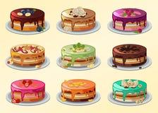 大套在动画片样式的蛋糕 图库摄影