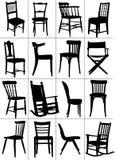 大套家庭椅子剪影 库存图片