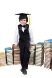 大学盖帽的小男孩有旧书的 库存图片