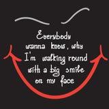大家要知道我为什么走在周围与在我的面孔诱导行情字法的大微笑 库存照片