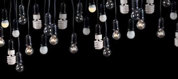 大小组在容器的灯在黑色 库存图片