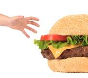 大开胃汉堡包和手 库存照片