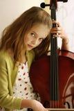 大提琴女孩使用 免版税库存照片