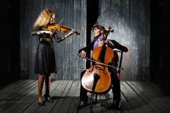 大提琴音乐家小提琴 免版税图库摄影