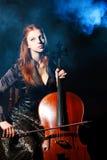 大提琴神秘音乐的音乐家 图库摄影