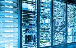 大数据黑暗的服务器室用明亮的设备 图库摄影
