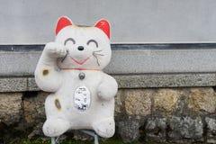 大日本人Manekineko幸运的猫玩偶 图库摄影