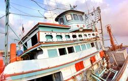 大木渔场小船 免版税库存图片