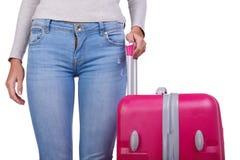 大桃红色手提箱在妇女在一白色backkground隔绝的` s手上 免版税库存图片
