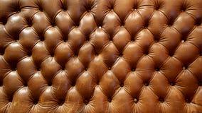 大棕色皮革长沙发纹理 库存照片