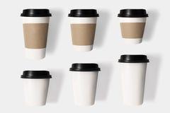 大模型咖啡杯的设计观念在白色ba设置了  免版税图库摄影