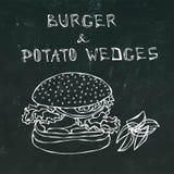 大汉堡包或乳酪汉堡与土豆楔子 汉堡字法 隔绝在黑黑板背景 可实现 免版税库存图片