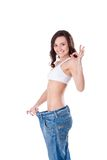 大牛仔裤减肥妇女 库存照片