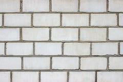 大理石墙壁在城市构造了一块石头的背景细节,装饰的门面 库存照片