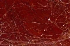 大理石红色碧玉纹理背景的真正的自然样式 库存照片
