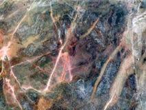 大理石纹理和铁锈颜色浅粉红色的裂缝  库存照片