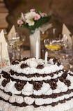 大生日巧克力和泡沫在桌结块 免版税库存照片