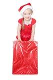大礼品女孩帽子小的红色圣诞老人丝&# 图库摄影
