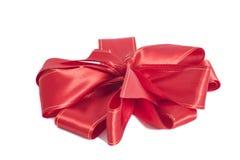 大红色缎礼物弓 丝带 免版税库存照片