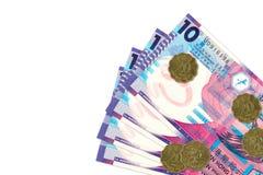 大约10张香港钞票正面与20香港分硬币 库存图片