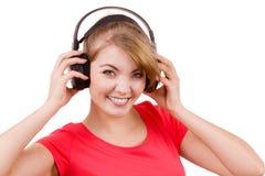 大耳机听的音乐的妇女被隔绝 免版税库存图片