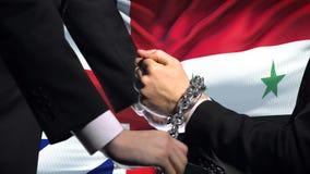 大英国认可叙利亚,被束缚的胳膊,政治或者经济冲突 股票视频