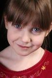 大蓝眼睛面对女孩 图库摄影