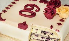 大蛋糕为第60个生日,符号食物 免版税库存图片