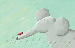大象和红色鸟 库存照片