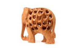 大象木手工制造小雕象白色背景 库存照片