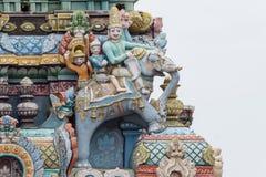以大象的Gopuram的角落三个人为特色 免版税图库摄影