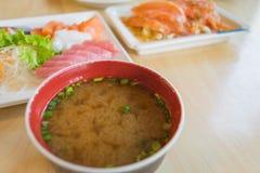 大酱汤和弄脏其他三文鱼鱼未加工在桌上 库存图片