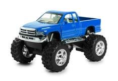 大金属红色玩具汽车越野与在白色背景隔绝的妖怪轮子 免版税库存照片