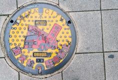 大阪,日本- 2016年11月19日:人孔盖在大阪,日本 免版税库存照片