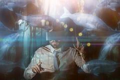大鱼游泳的综合图象在坦克的 免版税库存照片